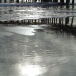 Pier and Sun Reflections